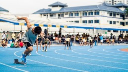 asian-runner-sprinting-on-track-from-starting-position