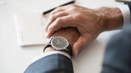 man-checking-wristwatch-impatiently